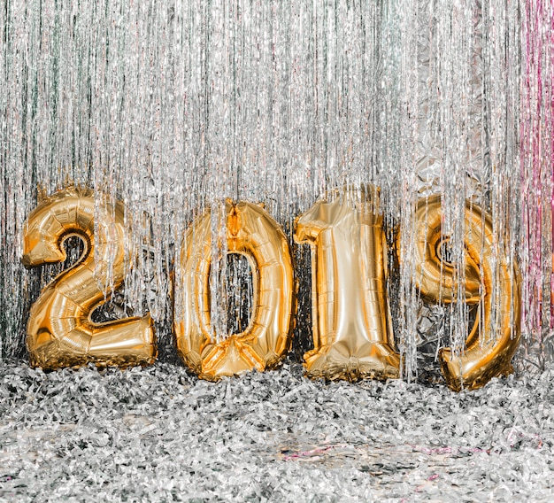 Golden balloons new year party Free Photo