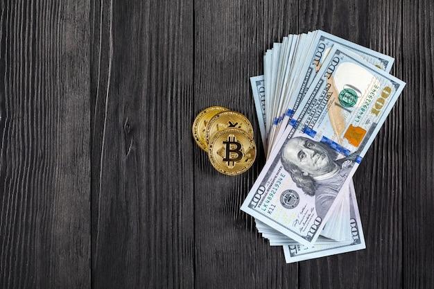 Golden bitcoin coin on us dollars Premium Photo