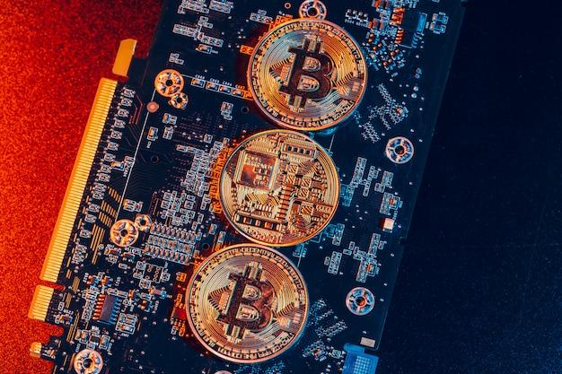Golden bitcoin and computer chip Premium Photo