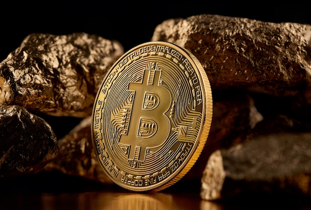 Golden bitcoin and gold lumps representing futuristic world trends both isolated on black background Premium Photo
