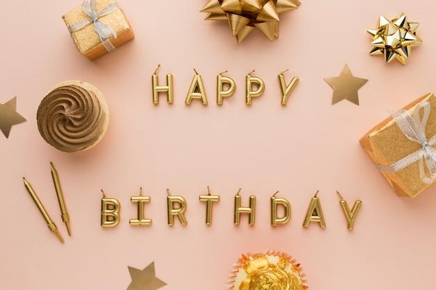 Golden candles with happy birthday Premium Photo