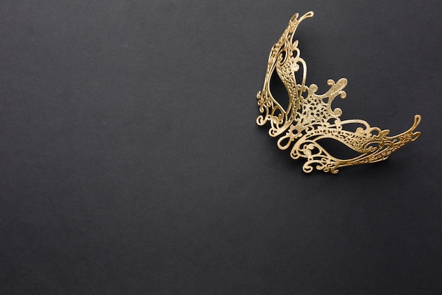 Golden carnival mask with copy space Free Photo