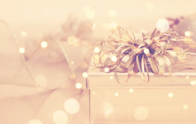 Golden christmas background with gifts Free Photo