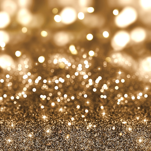 Golden christmas glitter background with stars and bokeh lights Free Photo
