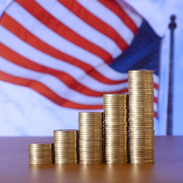Golden coin stacks arranged as a graph. Premium Photo
