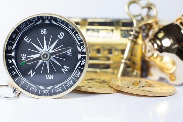 Golden compass guiding business investment Premium Photo