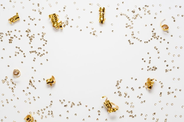 Golden confetti frame and copy space Free Photo
