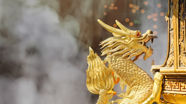 Golden dragon sculpture in shrine Premium Photo