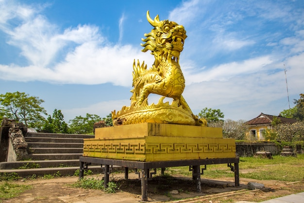 Golden dragon statue located inside imperial royal palace, forbidden city in hue, vietnam Premium Photo