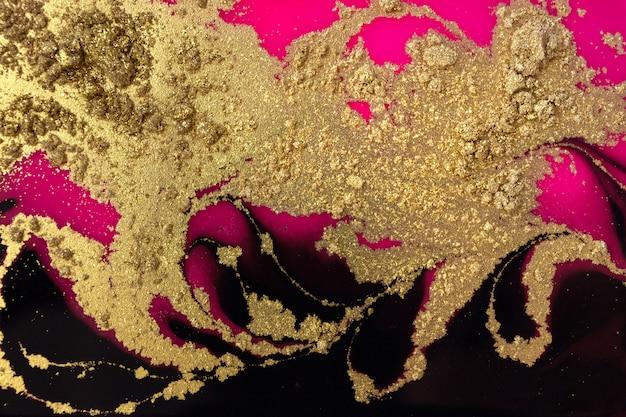 Golden dust, black and pink background. sparkling gold texture. Premium Photo