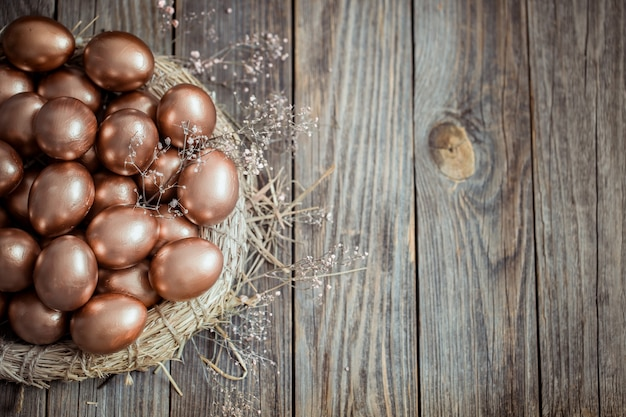 Golden easter eggs on a nest Free Photo