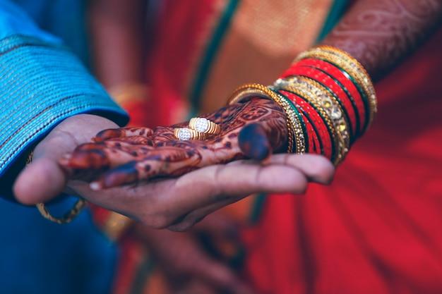 Golden engagement ring in couple hand Premium Photo