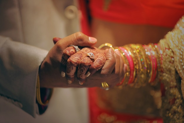 Golden engagement ring in hand Premium Photo