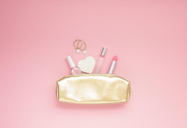 Golden female purse with cosmetics Premium Photo