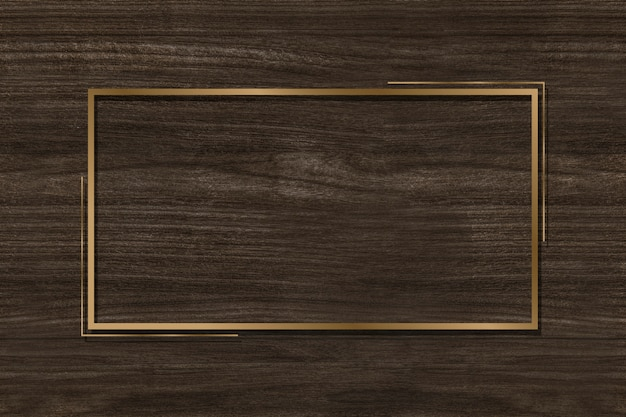 Golden frame on a brown background Free Photo
