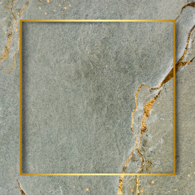 Golden frame on marbled background Free Photo