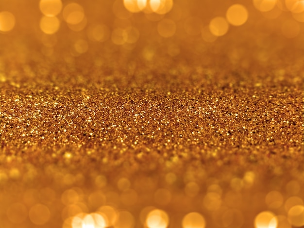 golden glitter defocused bokeh background Free Photo