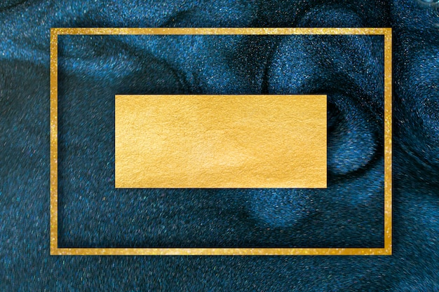 Golden glitter dust on dark blue background. Premium Photo