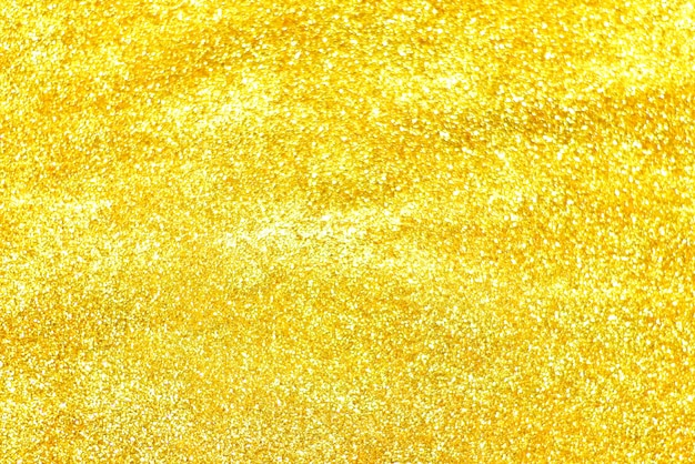 golden glitter texture colorfull blurred abstract background for birthday new year eve or christmas premium photo