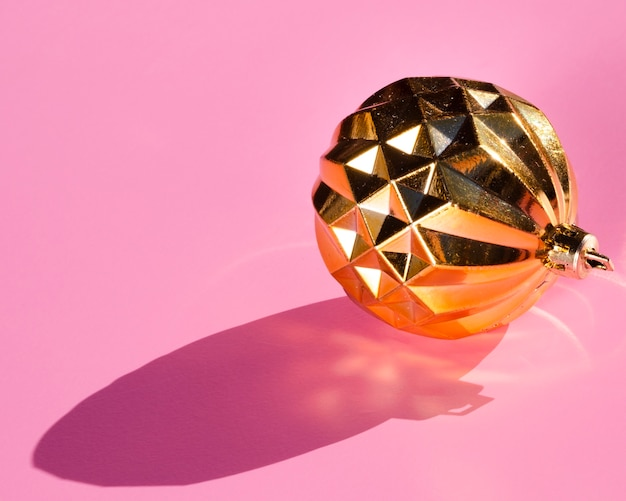 Golden globe on pink background Free Photo