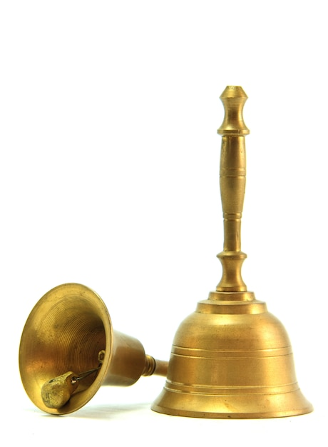 Golden hand bell isolated on white Premium Photo