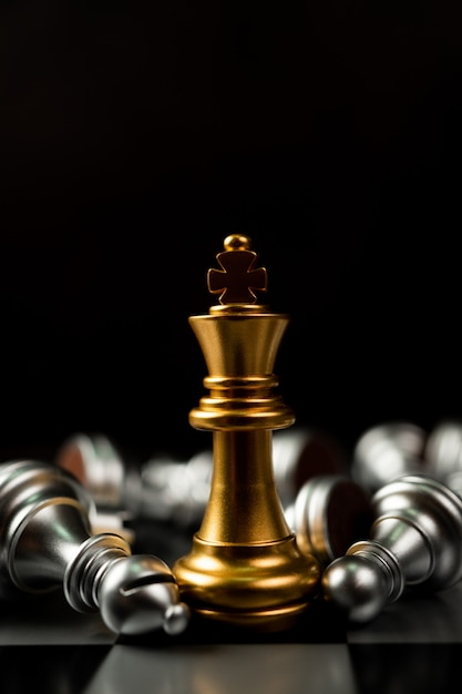 Golden king chess is last standing in the chess board Premium Photo