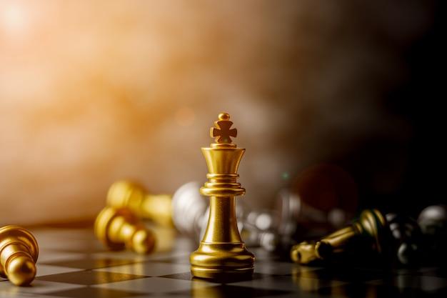 Golden king chess standing encounter defeat enemies. Premium Photo