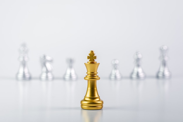 Golden king chess standing encounter enemies Premium Photo