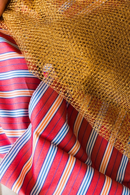 Golden lace on stripes garment Free Photo