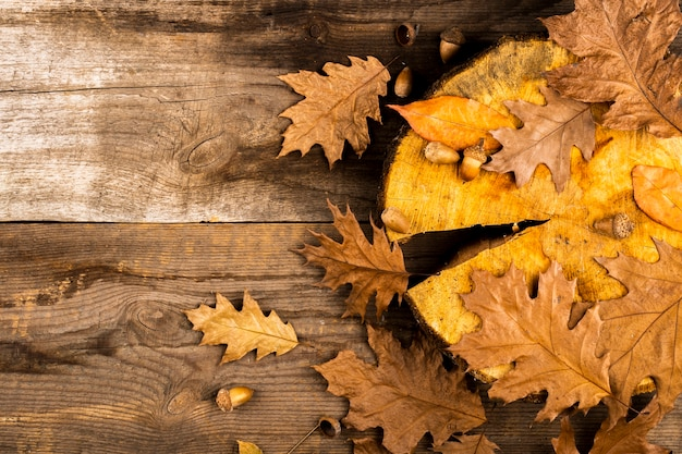 Golden leaves on wooden background copy space Free Photo