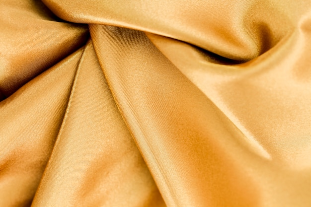 Golden material surface with twisted waves Free Photo
