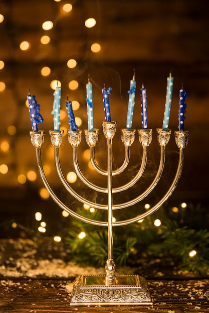 Golden menorah with candles Free Photo