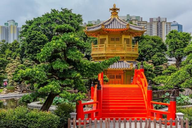Golden pagoda of nan lian garden in hong kong city with a cloudy sky, hongkong china Premium Photo