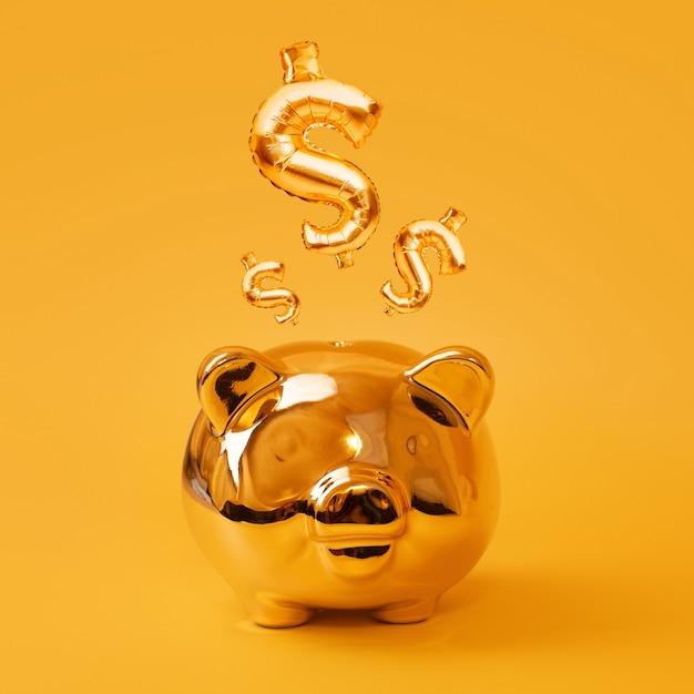Золотая копилка на желтом фоне с золотыми воздушными шарами знак доллара сша. золотой символ валюты из надувного воздушного шара из фольги. инвестиционная и банковская концепция. экономия денег, копилка, финансы, инвестиции. Premium Фотографии