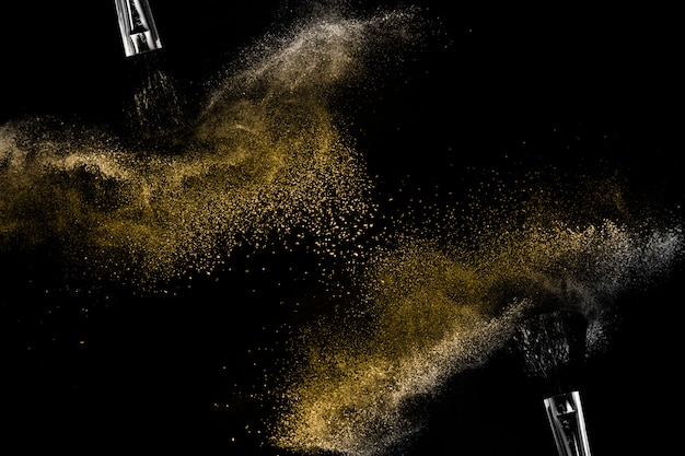 Golden powder black background Premium Photo