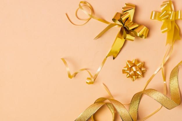 Golden ribbon on pink background Free Photo