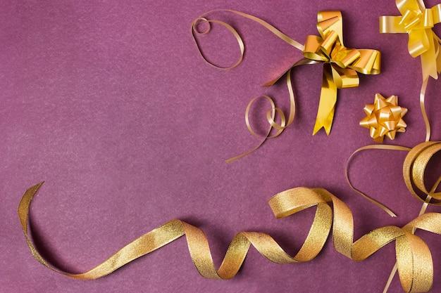 Golden ribbon on purple background Free Photo