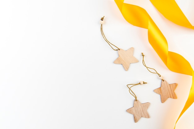Golden ribbons and stars copy space background Free Photo