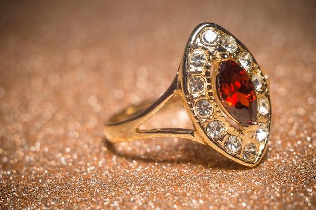 Golden ring with garnet Premium Photo