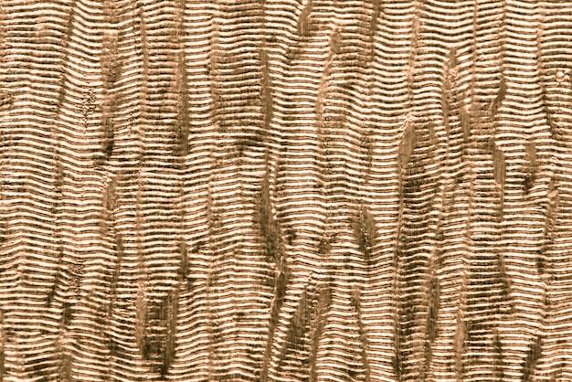 Golden shiny fabric textured background Free Photo