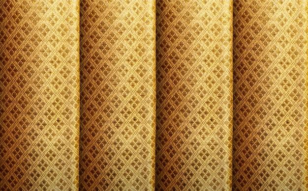 Golden silk with vintage royal pattern background Premium Photo