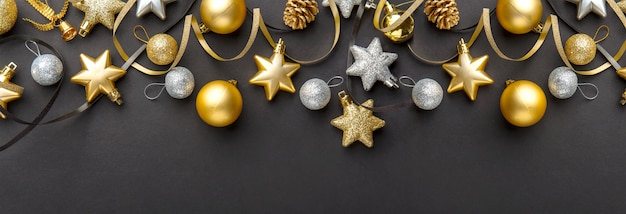 Golden silver christmas deco on black Premium Photo