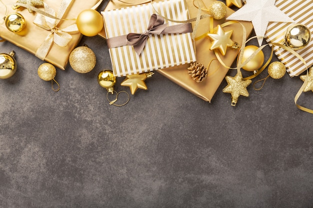 Golden silver christmas deco on grey Premium Photo