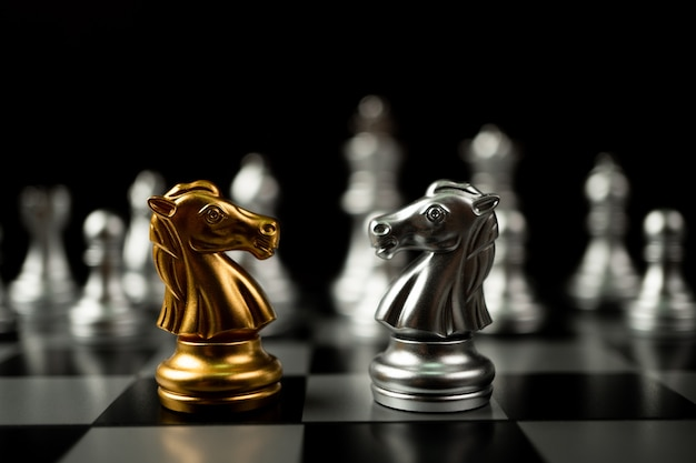 Golden and silver horse chess pieces Premium Photo