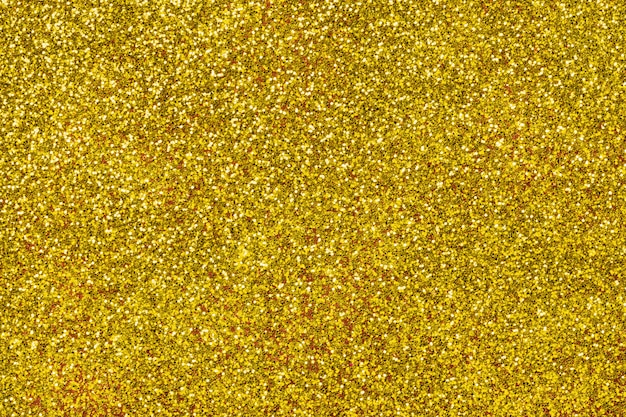 Golden sparkling background from small sequins Premium Photo