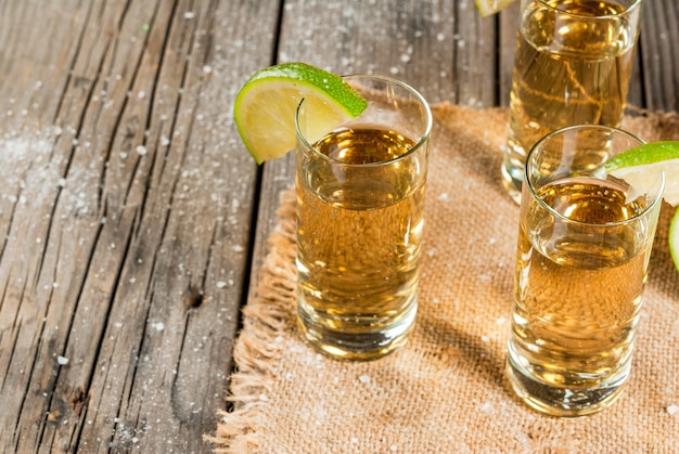 Golden tequila with lime Premium Photo