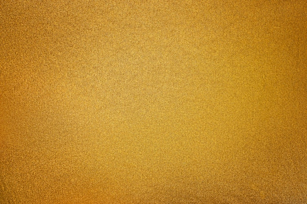 Golden texture with a lightspot background Free Photo