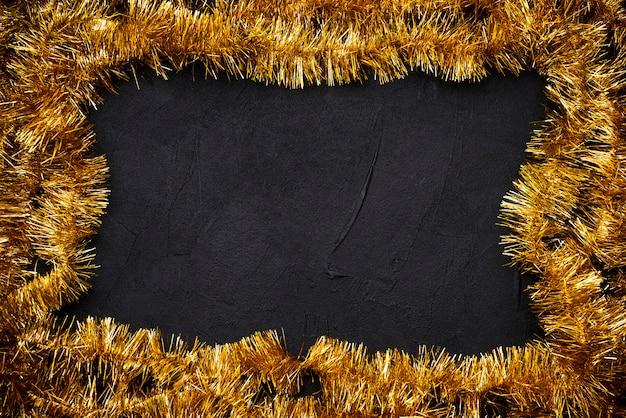 Golden tinsel frame for christmas Free Photo