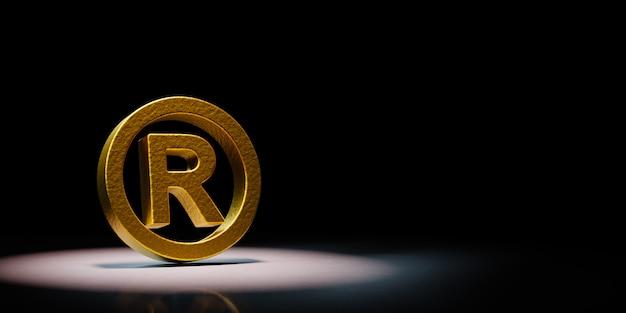 Golden trademark symbol spotlighted on black background Premium Photo