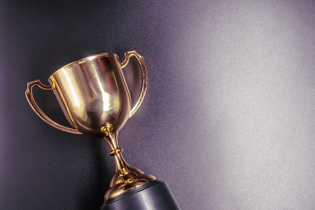 Golden trophy on black background Premium Photo